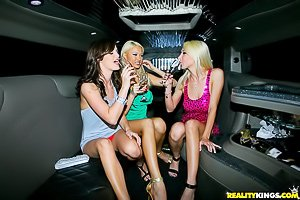 Leggy party girls in dresses enjoying hardcore lesbian sex in a limo