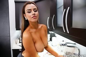 Tanned maid with massive tits cleaning the kitchen while naked