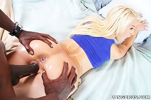 Pale blonde in purple lingerie gets fucked from behind by a black dude