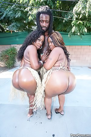 Two oiled-up ebony hotties getting fucked by a big-dicked black dude