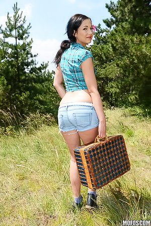 Denim shorts dark-haired beauty getting fucked in the ass outdoors