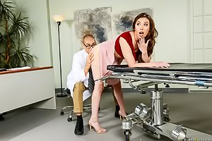 Skirt-wearing auburn-haired beauty getting pounded by her doctor