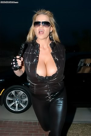 Shades-wearing badass blonde MILF in leather does naughty stuff
