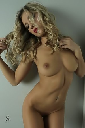 Wavy-haired blonde masturbating on a red couch like a total whore