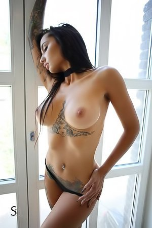 Tanned brunette with tats gets choked and subtly teased by a hung stud