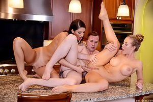 Shades-wearing curvy beauty and her jacked-up MILF GF end up in an FFM