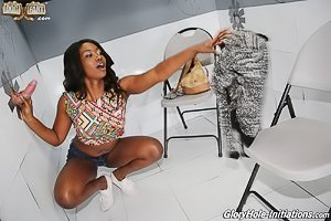 Ebony teen in shades sucking a meaty white cock via a glory hole