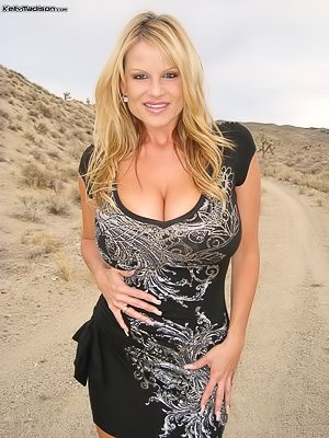 Dress-wearing curvaceous MILF blonde sucking cock in the desert
