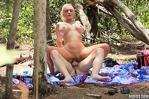 Busty blonde getting brutally pounded doggy style in the woods
