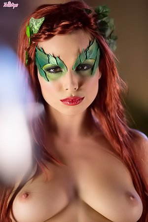 Redheaded Poison Ivy chick decides to tease her pussy with a toy