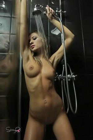 Wet blonde with perfect tits showing off her body in the shower