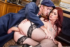 Luxurious-looking redhead in stockings gets banged by a smooth criminal