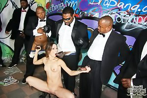 Exotic-looking brunette in a red dress gang-banged by black dudes