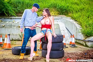 Pouty brunette in denim shorts gets face-fucked next to some tires