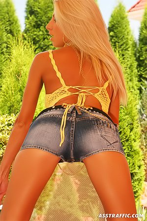 Denim shorts blonde shoves a red butt-plug up that tight asshole