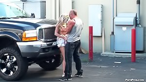 Trashy blonde with killer curves gets banged next to a black car