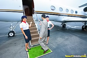 First-class service from two sexed-up flight attendants in tight skirts