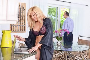 Blond-haired MILF housewife fucking a much younger guy in the kitchen