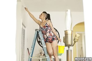Ponytailed brunette with shaved sides fucked next to a ladder