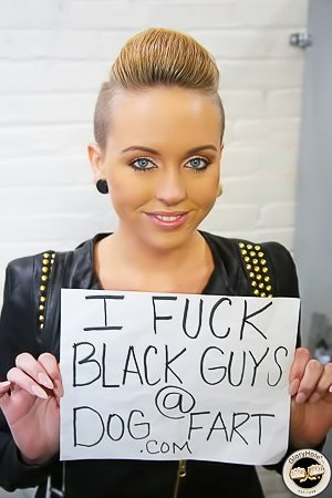 Blond-haired beauty with shaved sides enjoying black cocks via a glory hole