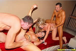 Horny party girls get banged together by some sweaty dudes with big cocks