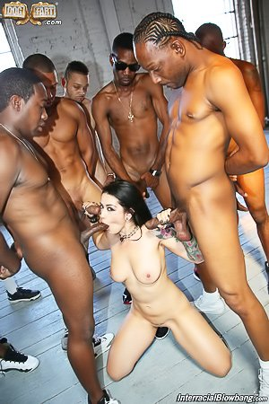 Tatted-up brunette with nice tits gets gang-banged by black dudes